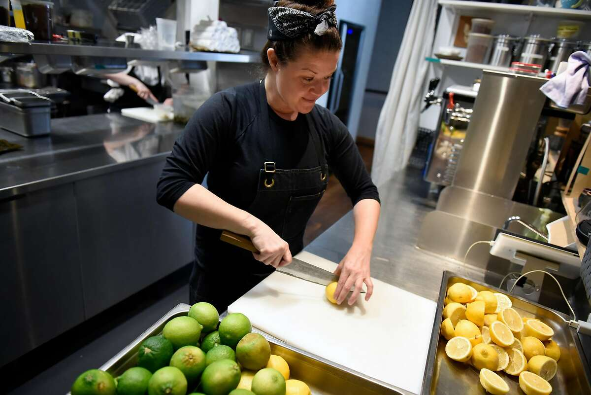 Head chef Kim Alter slices citrus that will be juiced and used for cocktails in the bar, at Nightbird restaurant in San Francisco, Calif., Friday March 30, 2018.
