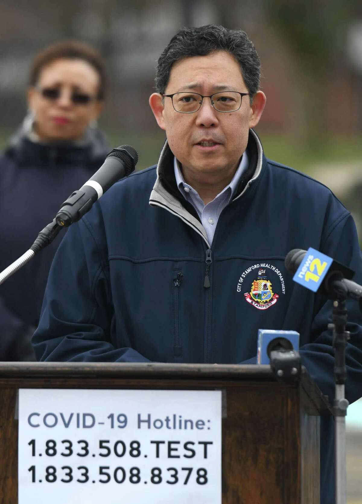 City of Stamford Medical Advisor Dr. Henry Yoon speaks about the coronavirus situation at Westhill High School in Stamford, Conn. Monday, March 30, 2020.