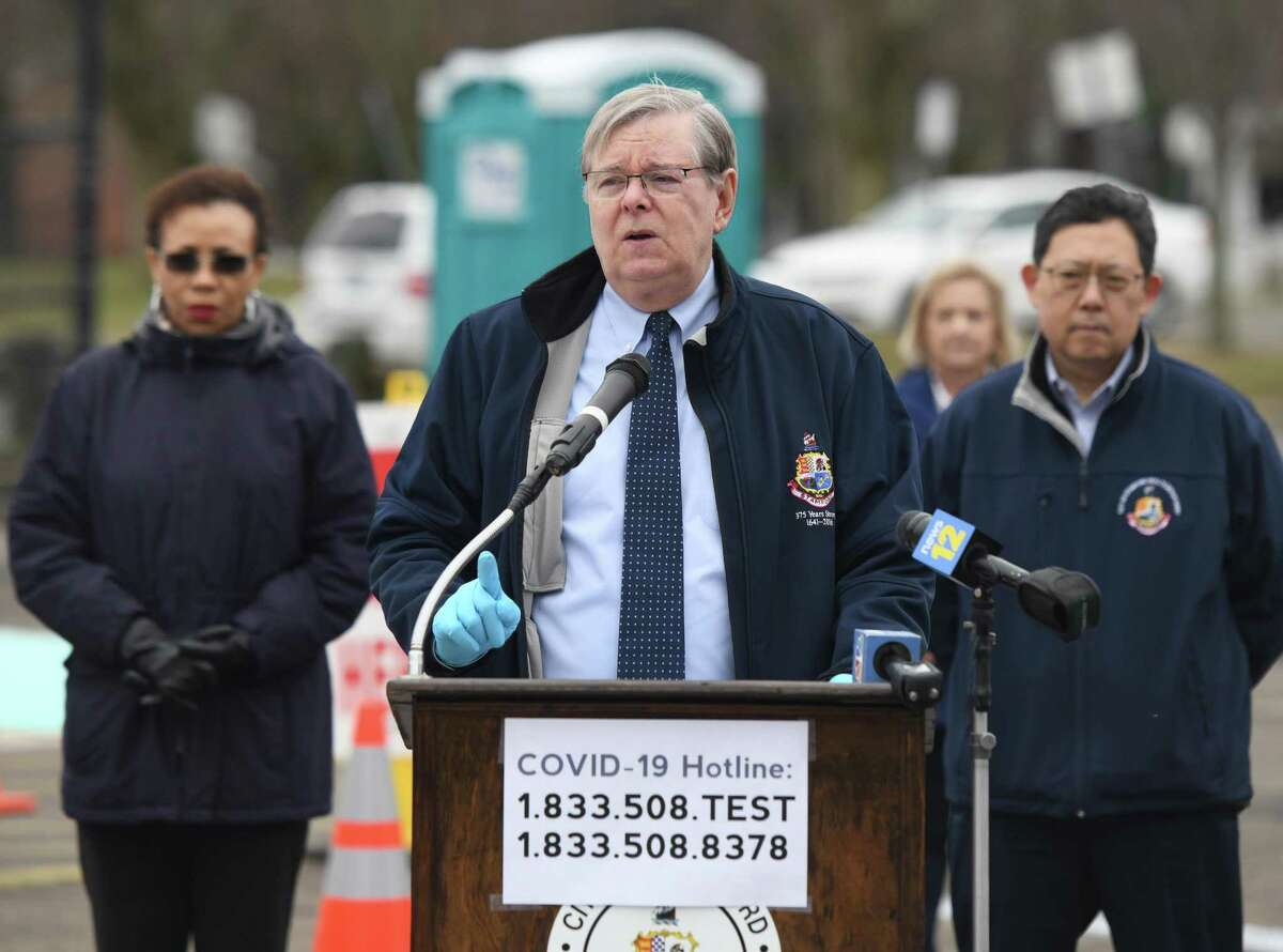Stamford Mayor David Martin speaks about the coronavirus situation at the new testing center at Westhill High School in Stamford, Conn. Monday, March 30, 2020. The new COVID-19 drive-thru testing site will begin operation on Tuesday, joining three others already operating in Stamford. In addition, the mayor announced a new hotline number, 1-833-508-TEST, to provide a smoother transition for residents seeking testing.