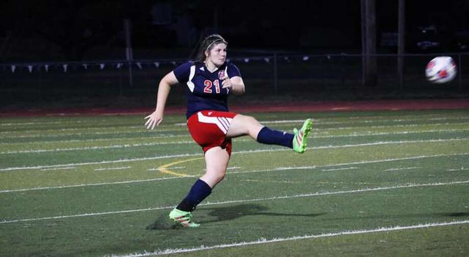 Emily Kolo blasts a pass down the field during a game with MacMurray College. Kolo is in her senior year at MacMurray College, which is closing its doors in May after 174 years.