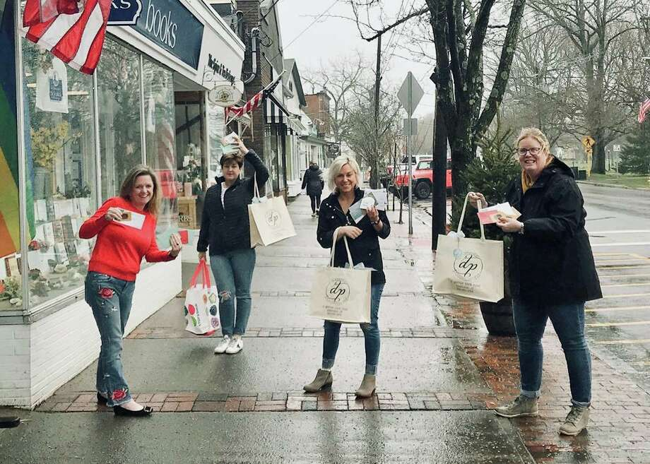 The Gift Card Project is the brainchild of (l-r) Meghan McCartan, Amy Stefanowski, Nicole White and Catherine Kiernan Marganski. Photo: Contributed