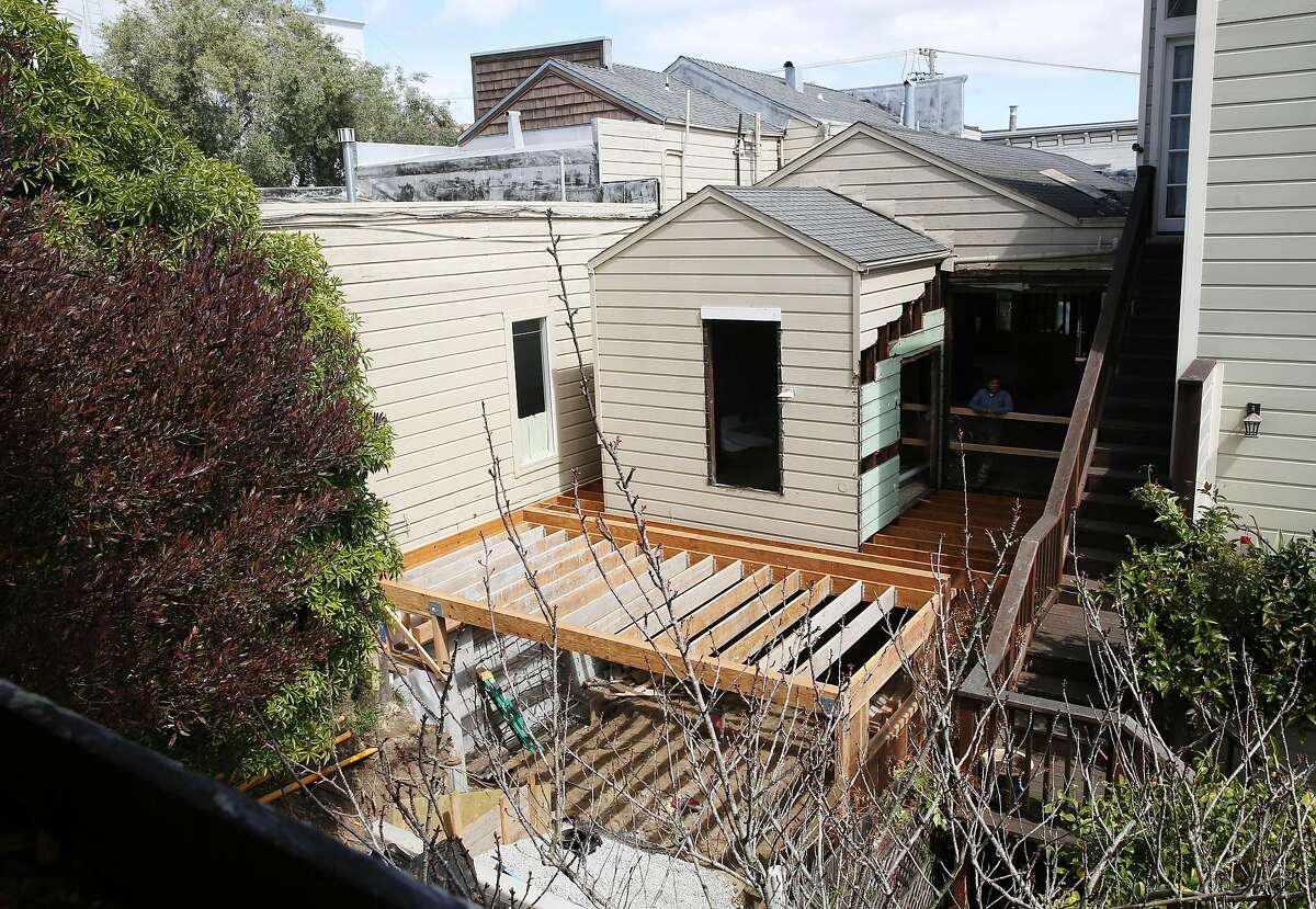 The view of work being done on 1819 Baker Street seen from Clarkson and Leggitt's back stairs at their home on Monday, March 30, 2020 in San Francisco, Calif.