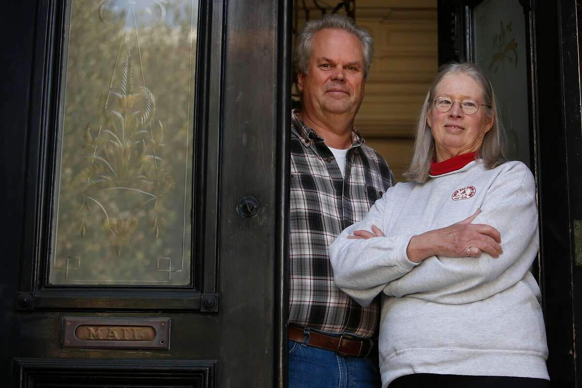 Roy Leggitt and Courtney Clarkson stand for a portrait in the doorway of their home on Monday, March 30, 2020 in San Francisco, Calif.