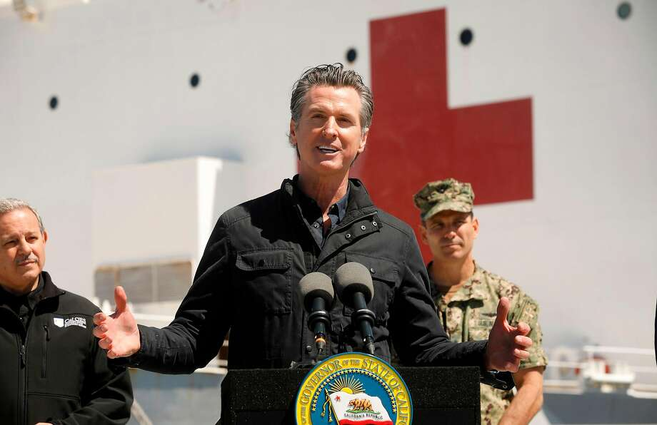 California Governor Gavin Newsom (C) speaks in front of The USNS Mercy, a giant US naval hospital ship, arrived in Los Angeles on March 27, where it will be used to ease the strain on the city's coronavirus-swamped emergency rooms. Photo: Carolyn Cole/AFP Via Getty Images