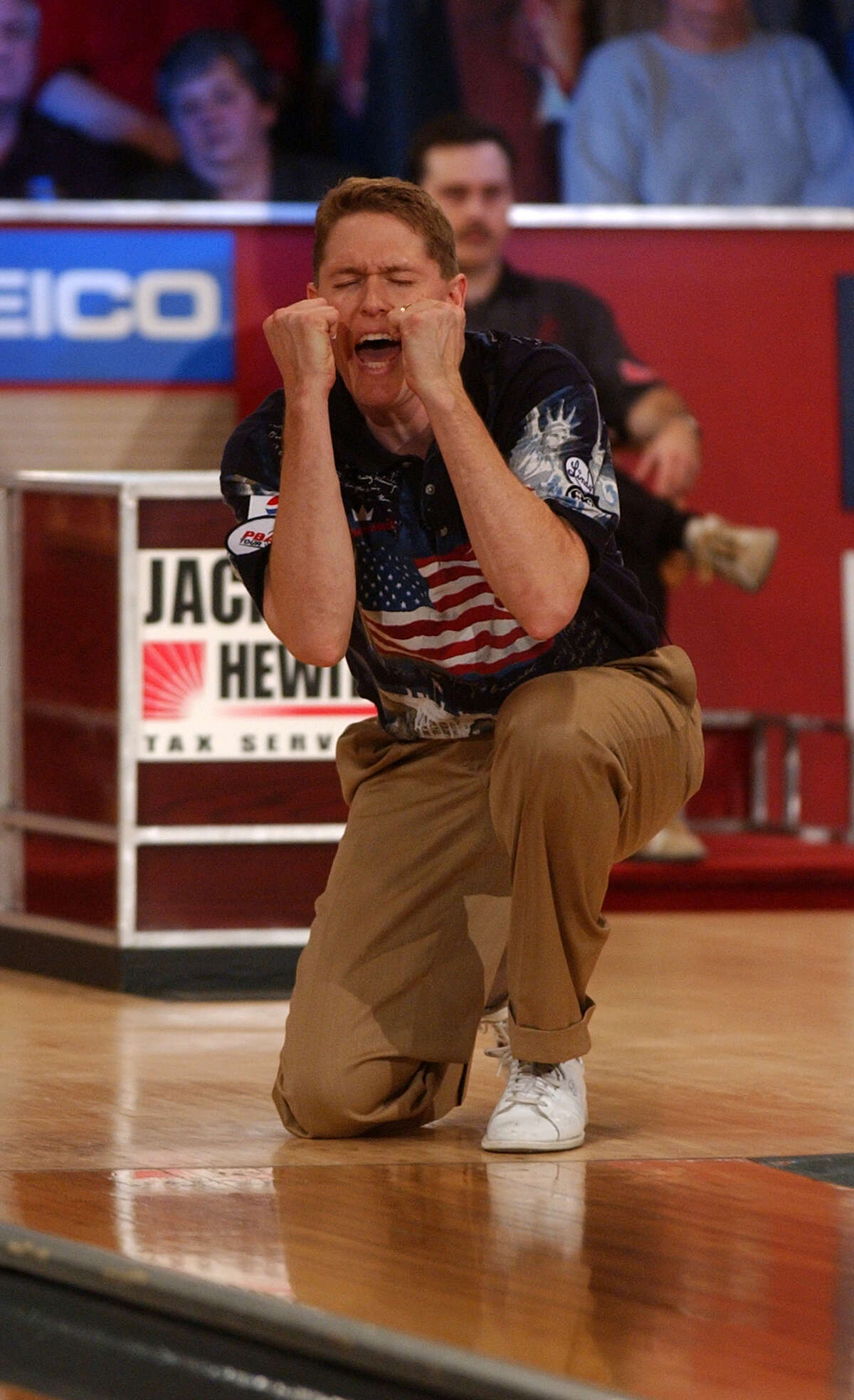 Times Union staff photo by Paul Buckowski Chris Barnes reacts to a strike he had just bowled in the Championship Match of the PBA Empire State Open on Sunday Nov. 23, 2003 at the Bowler's Club in Latham, N.Y. Barnes lost the match however to Ryan Schafer.