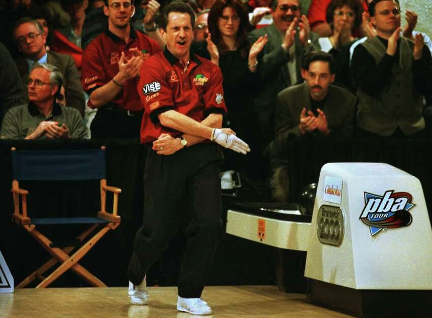 Times Union Staff Photo by Michael P. FARRELL -- Pete Weber , forms a strike mark with his hands after winning the PBA Parker Bohn III Empire State Open at the Bowlers Club in Latham Saturday Feb. 12. 2000.