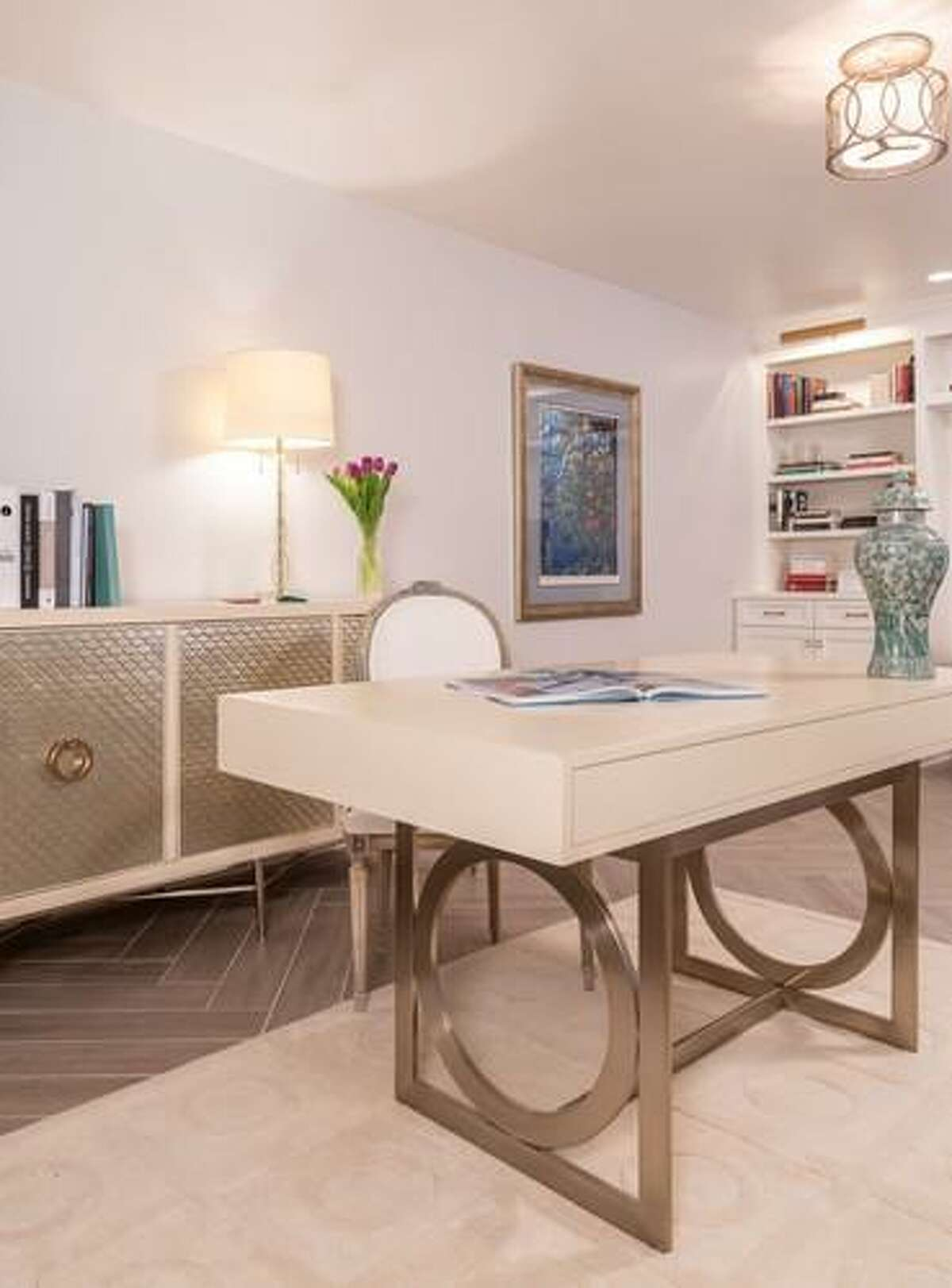 Sophia and Anthony Vassiliou share office space in their Nottingham Forest home. Sophia's half of the room has this functional desk and credenza.