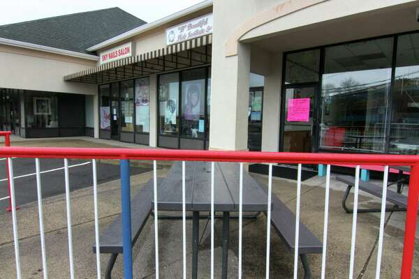 Businesses at Merchant Walk that are considered non-essential are closed due to the coronavirus in Stratford, Conn., on Saturday Mar. 28, 2020.