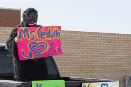 Bowie Fine Arts teachers line the parking areas 03/30/2020 as parents drive their students around the school to say hi and encourage them. Tim Fischer/Reporter-Telegram