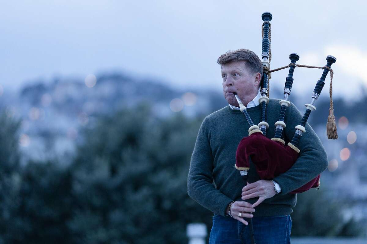 Bagpiper Hal Wilkes plays for his neighbors on his building�s rooftop to make people feel united during the shelter-in-place order due to the COVID-19 pandemic on Friday, March 27, 2020, in San Francisco, Calif.