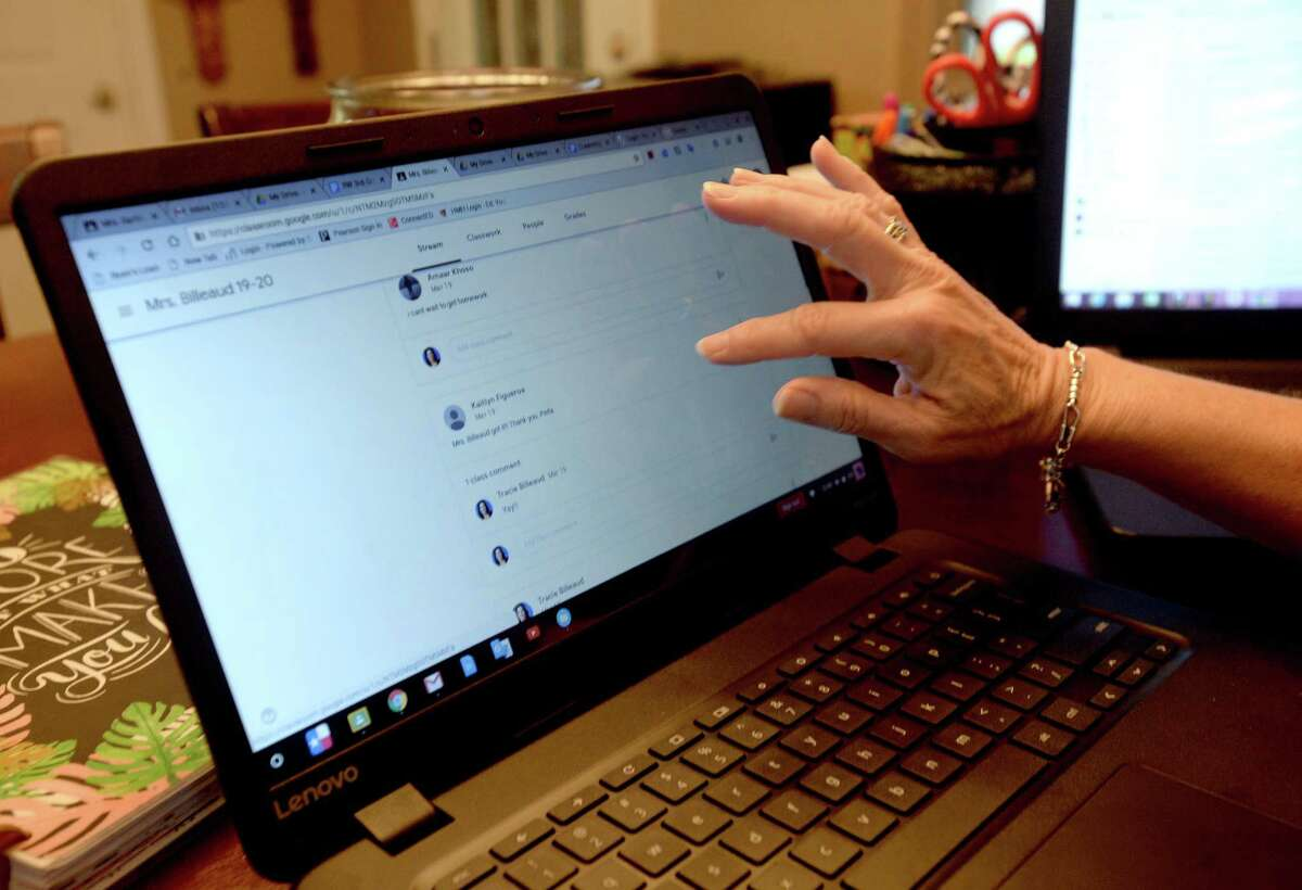 Tracie Billeaud, a third grade teacher at Ridgewood Elementary School in Port Neches, scrolls through messages from students as she does some final work online from her home-based teaching set-up. Billeaud says her students are excited to continue learning, and as of late Friday all have now been able to get signed in and access the site, which includes a group chat area where they can communicate with her and one another. She even has shown them a photo of their class fish