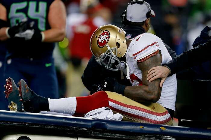 NaVorro Bowman is taken off the field after a second half injury Sunday January 19, 2014. The Seattle Seahawks defeated the San Francisco 49ers 23-17 to win the NFC championship and a trip to the Super Bowl at CenturyLink Field in Seattle, Washington.