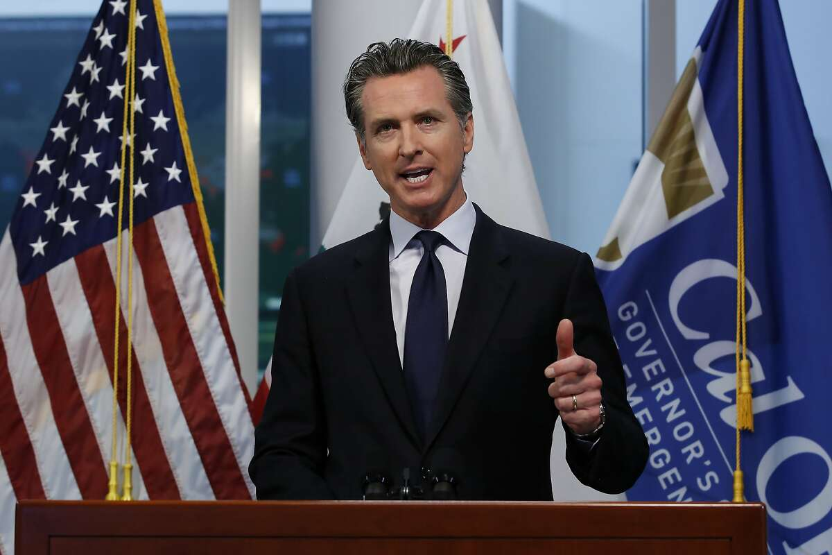 Gov. Gavin Newsom updates the state's response to the coronavirus, at the Governor's Office of Emergency Services in Rancho Cordova, Calif., Monday, March 30, 2020. Newsom announced the state is enlisting retired doctors and medical and nursing students to help treat an anticipated surge of coronavirus patients. (AP Photo/Rich Pedroncelli, Pool)