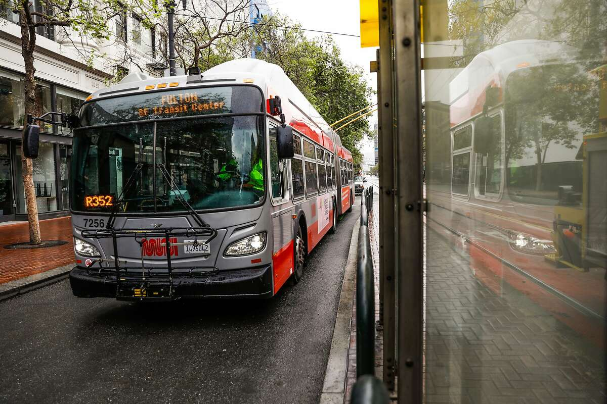 A MUNI bus rides down Market Street during the second week of shelter in place orders due to the coronavirus on Sunday, March 29, 2020 in San Francisco, California.