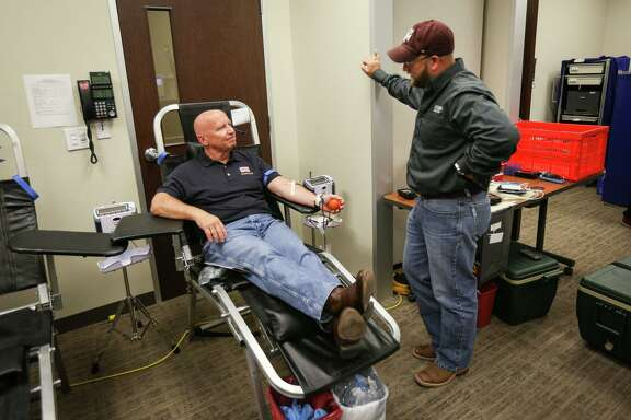 U.S. Rep. Kevin Brady, R-The Woodlands, chats with Marine Corps veteran Jeremy Williams while giving blood during the Gulf Coast Regional Blood Center's blood drive for victims of Las Vegas on Friday, Oct. 6, 2017, at the Conroe VA Outpatient Clinic.