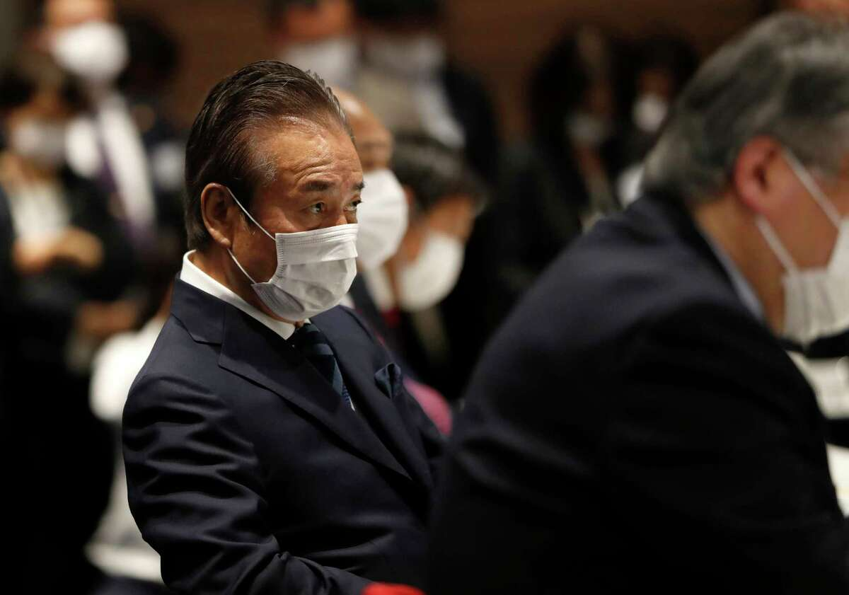 Haruyuki Takahashi, executive board member of the Tokyo Organizing Committee of the Olympic and Paralympic Games attends the Tokyo 2020 Executive Board Meeting in Tokyo, Japan Monday, March 30, 2020. Tokyo Olympic President Yoshiro Mori said Monday he expects to talk with IOC President Thomas Bach this week about potential dates and other details for the rescheduled games next year. (Issei Kato/Pool Photo via AP)