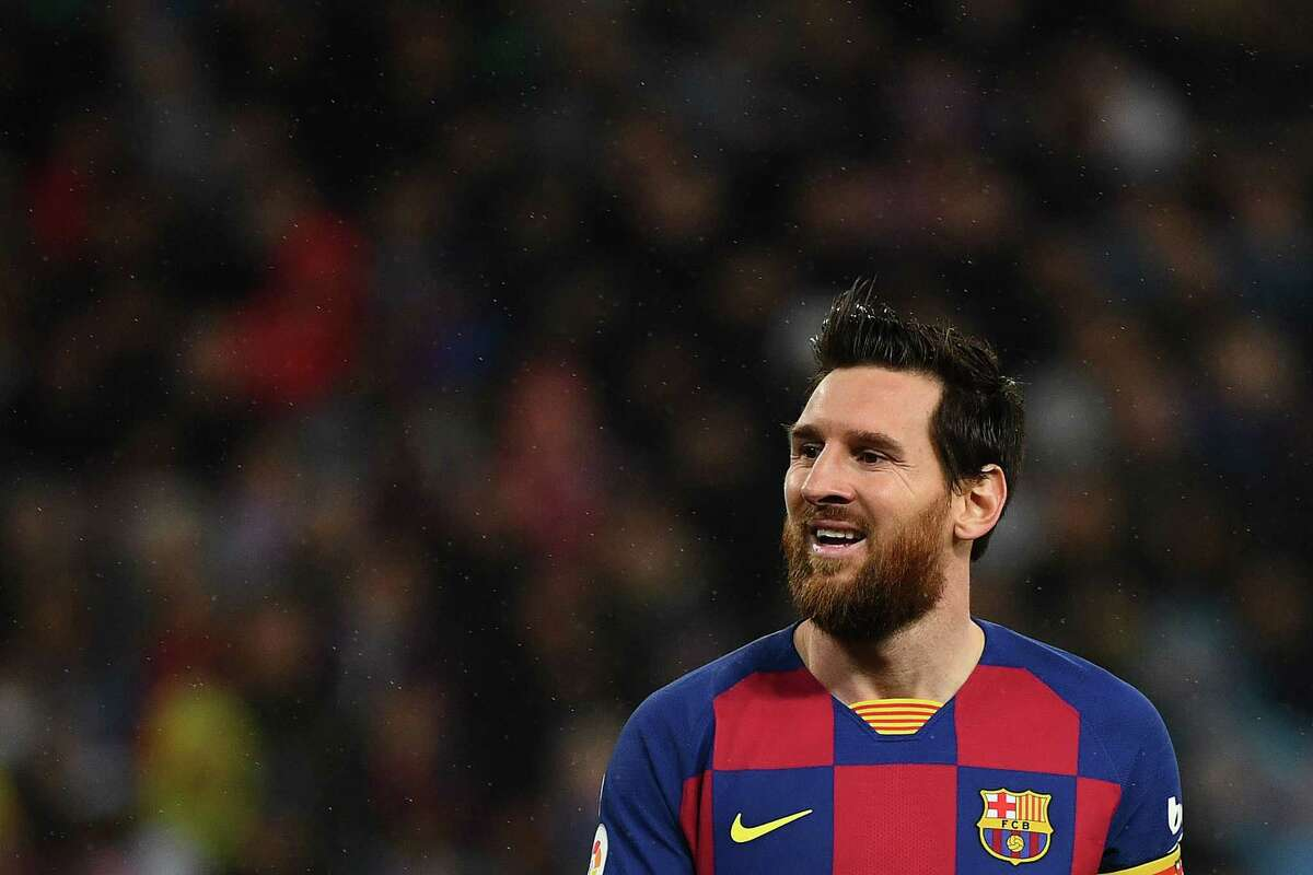 Barcelona's Argentine forward Lionel Messi smiles during the Spanish League football match between Real Madrid and Barcelona at the Santiago Bernabeu stadium in Madrid on March 1, 2020. (Photo by GABRIEL BOUYS / AFP) (Photo by GABRIEL BOUYS/AFP via Getty Images)