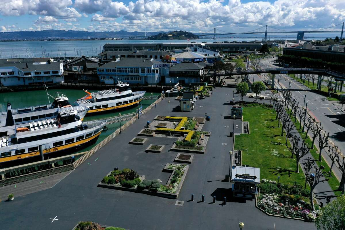 An aerial view from a drone shows streets virtually deserted at the Pier 39 tourist destination on March 26, 2020 in San Francisco, California.