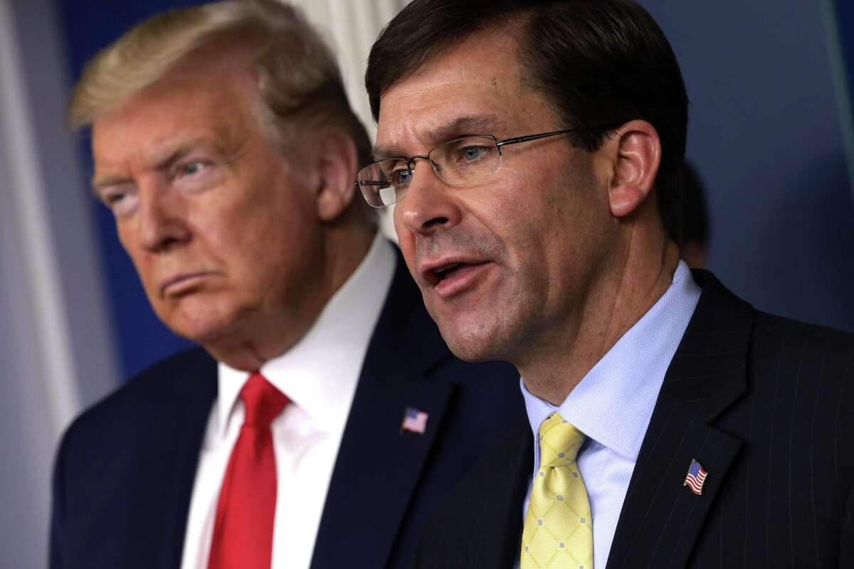 U.S. Secretary of Defense Mark Esper speaks as President Donald Trump listens during a White House news briefing on the latest development of the coronavirus outbreak on March 18. (Photo by Alex Wong/Getty Images)