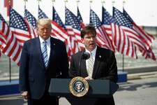Defense Secretary Mark Esper speaks as President Donald Trump listens during an event in front of the U.S. Navy hospital ship USNS Comfort at Naval Station Norfolk in Norfolk, Va., on Saturday. The ship is departing for New York to assist hospitals responding to the coronavirus outbreak. (AP Photo/Patrick Semansky)