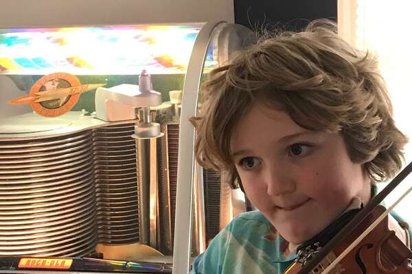 Nine-year-old Ridgefielder Austin Wakin is traveling to people's homes to play Happy Birthday, outside, on his violin.