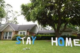 "Letters that read ""STAY HOME"" in the front yard of this home in Central Northwest Houston, Monday, March 30, 2020."