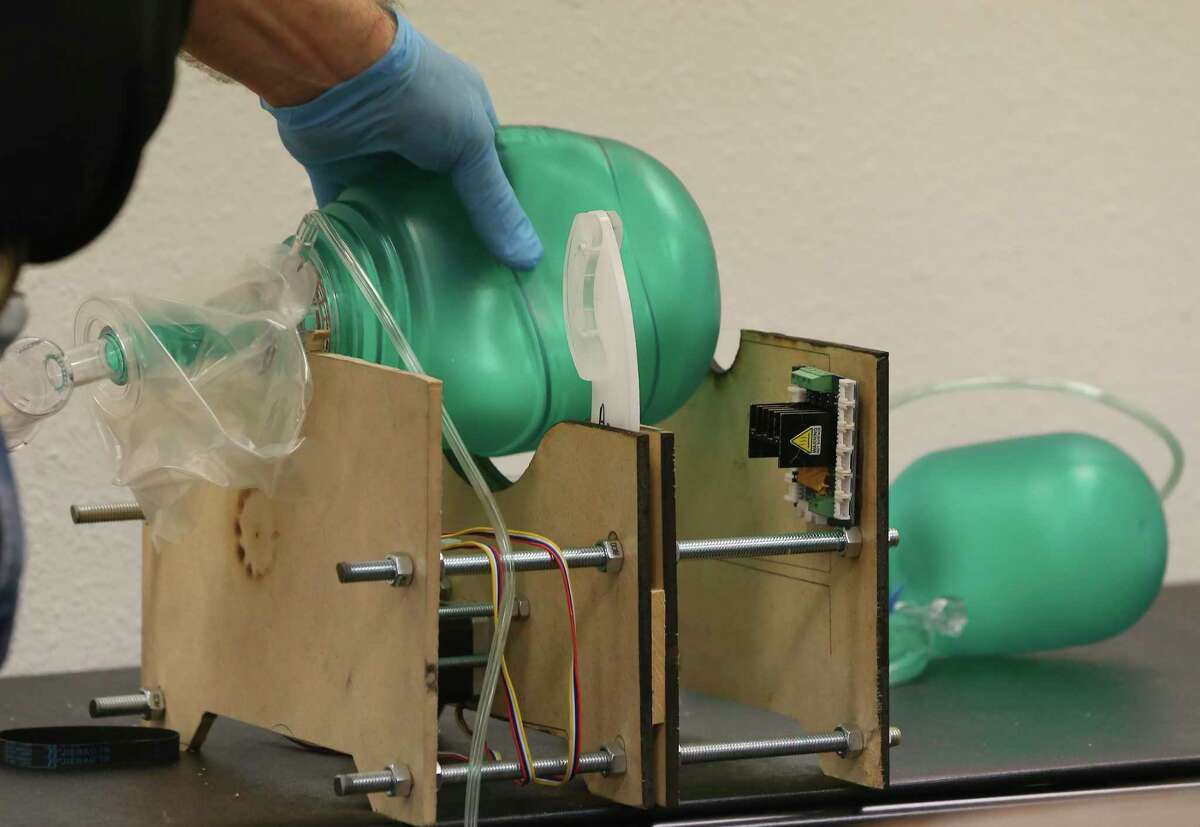 Placette demonstrates a prototype ventilator Friday. The device is meant to bridge a shortage of full-sized ventilators.