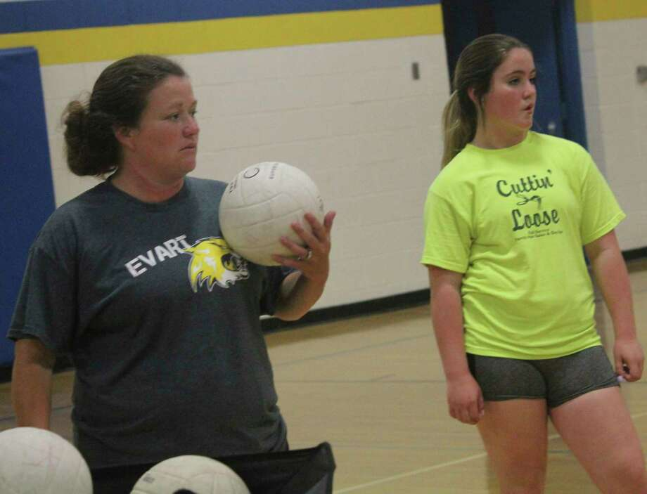 Evart coach Amanda Brown (left), pictured here working with her volleyball team last summer, hopes to be coaching the softball squad this spring. (Pioneer file photo)