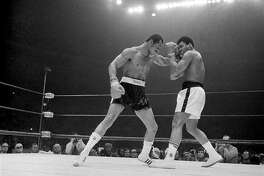Ken Norton lands a left to the face of Muhammed Ali during their heavyweight bout at the Sports Arena in San Diego, California on March 31, 1973. Ali lost to Norton on a split decision. (AP Photo/Jeff Robbins)