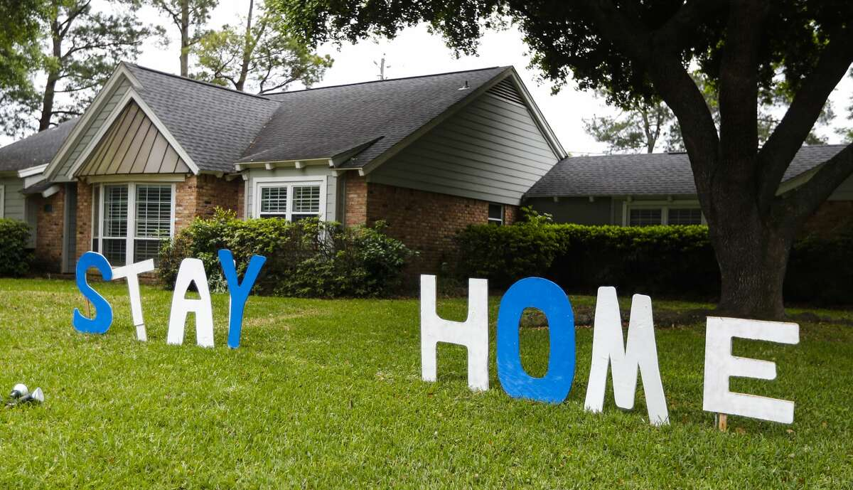 """Letters that read """"STAY HOME"""" in the front yard of this home in Central Northwest Houston, Monday, March 30, 2020."""