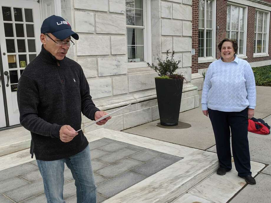 In an age of social distancing, First Selectman Fred Camillo had an audience of one for the town's official observation of Greek Independence Day on March 25. Camillo was joined by Board of Estimate and Taxation Chair Karen Fassuliotis, who had put the event together to as a tribute to her own heritage and other Greek Americans in town. Photo: Ken Borsuk / Hearst Connecticut Media