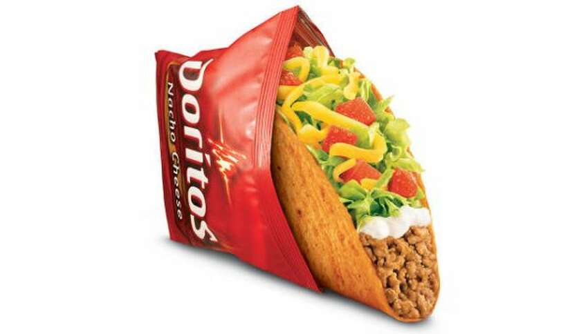 Nosh on a free nacho Doritos Locos Taco today only when you swing through any participating Taco Bell drive-thru.