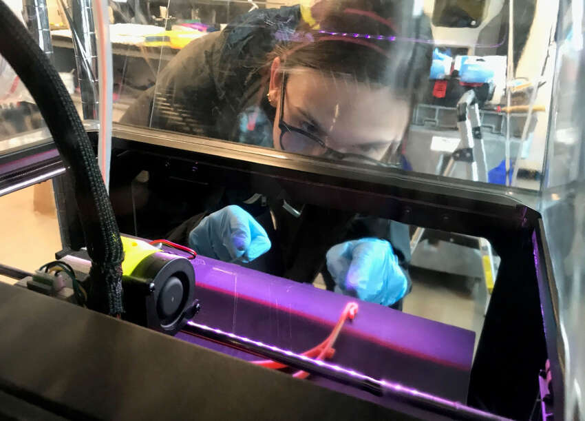 Rachel Eisgruber, senior in the mechanical engineering program at SUNY New Paltz printing face shield parts on the HVAMC MakerBot array. (SUNY New Paltz)