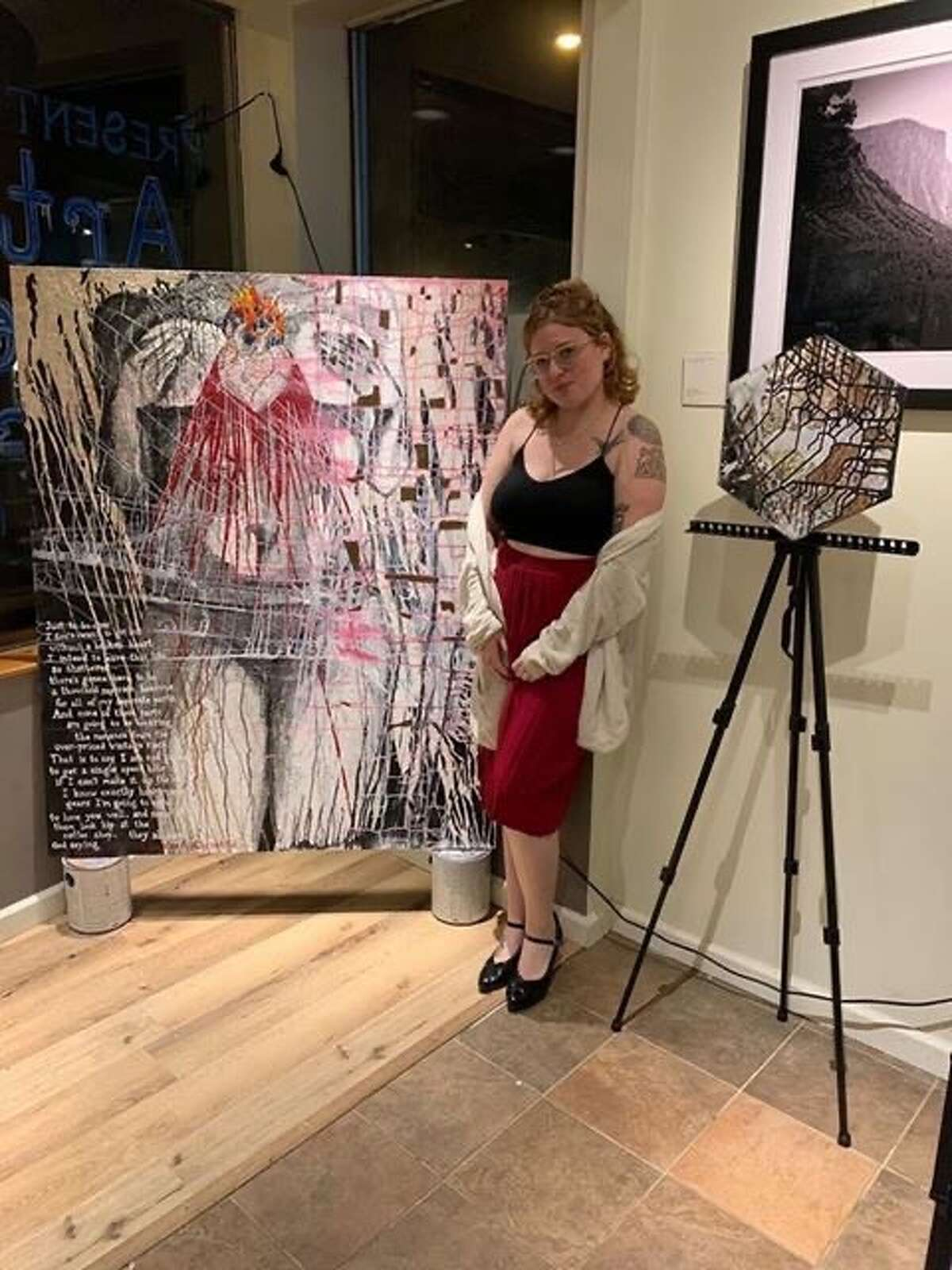 Kayla Fincken with some of her art:
