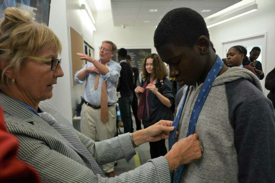 In an earlier Future 5 Job Prep session, Future 5 Founding Partner and longtime New Canaan resident Polly Perkins Johnson helps student members learn how to tie ties. Photo: Contributed Photo