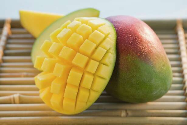 Cut mango on bamboo tray