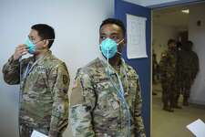 Members of the New York Army National Guard receive a fit test for their N95 protective masks at the State Department of Health Command Center in New Rochelle, New York, U.S., on Monday, March 16, 2020. The governors of New York, New Jersey and Connecticut banned all gatherings of 50 or more people, and said bars, restaurants, casinos and gyms must close Monday at 8 p.m. Photographer: Angus Mordant/Bloomberg
