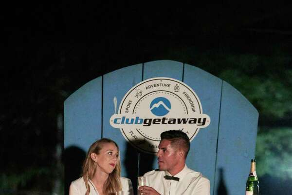 Club Getaway social coordinators Sophia D'Angelo and Adam Mizrahi during filming of Bravo TV's reality series 'Camp Getaway.'
