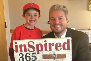 Darien's new Assistant Superintendent of Schools Christopher Tranberg with Granby fifth grade student Oliver Thrall.