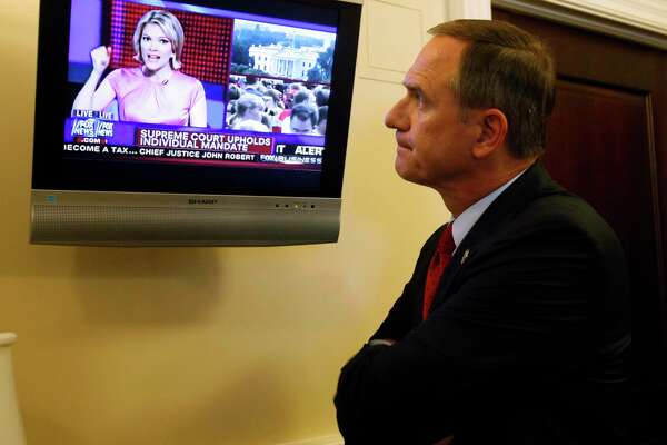 Del. Richard L. Anderson, R-Prince William reacts to the news that the Supreme Court upheld the Obama healthcare reform law from Megyn Kelly, America Live anchor on the Fox News channel, as he watches in the Virginia State Capitol in Richmond, Va. Thursday, June 28, 2012. (AP Photo/Richmond Times-Dispatch, Bob Brown).