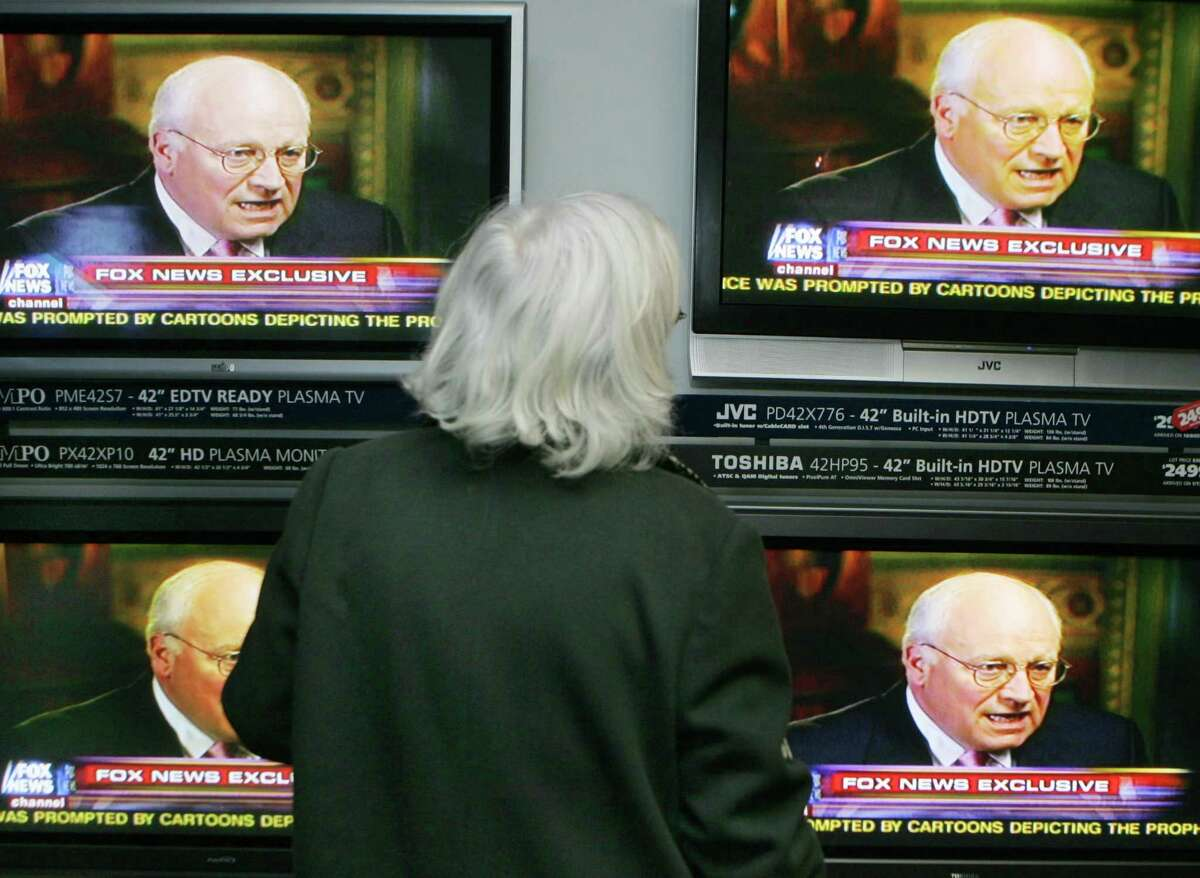 """Deborah McElwain, of Buffalo, N.Y., watches Vice President Dick Cheney speak on the Fox News Channel at Stereo Advantage in Williamsville, N.Y., Wednesday, Feb. 15, 2006. Vice President Dick Cheney on Wednesday accepted full blame for shooting a fellow hunter and defended his decision to not publicly disclose the accident until the following day. He called it """"one of the worst days of my life."""" (AP Photo/David Duprey)Ran on: 02-16-2006 Vice President Dick Cheney (left) talks with TV newsman Brit Hume about the accidental shooting in Texas for the first time during an interview Wednesday at the White House complex in Washington.Ran on: 02-16-2006 Vice President Dick Cheney talks with TV newsman Brit Hume about the accidental shooting in Texas for the first time during an interview Wednesday at the White House complex in Washington.Ran on: 02-16-2006 Vice President Dick Cheney talks with TV newsman Brit Hume about the accidental shooting in Texas for the first time during an interview at the White House complex in Washington."""