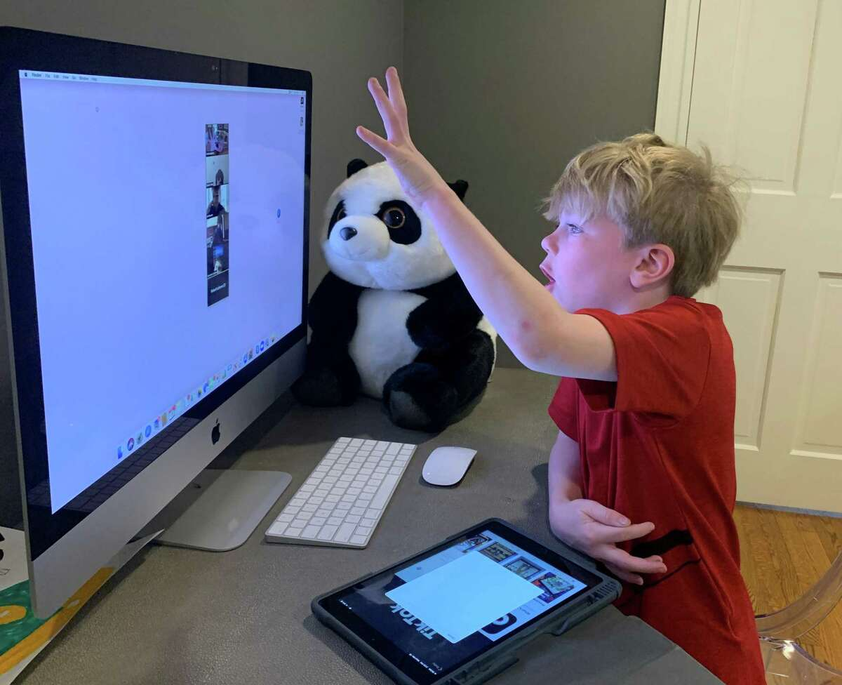 Luke Salib, 8, ZOOMs with his friends, all of whom are learning at home. Greenwich Public Schools has launched distance learning, and in its second week, parents are hoping to see more direct instruction through tele-conferencing platforms.