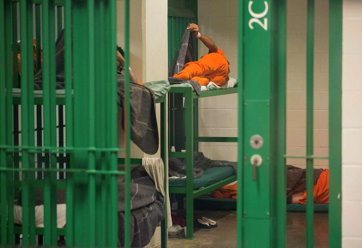 Inmates in a block of cells at the Harris County jail, Thursday, March 29, 2018, in Houston.