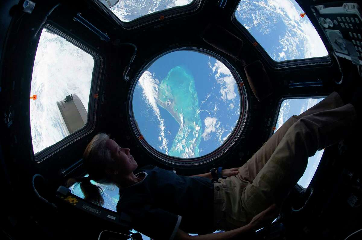 This NASA handout photo shows Shannon Walker looking out of the International Space Station's cupola at the Caribbean view beneath on Nov. 25, 2010.