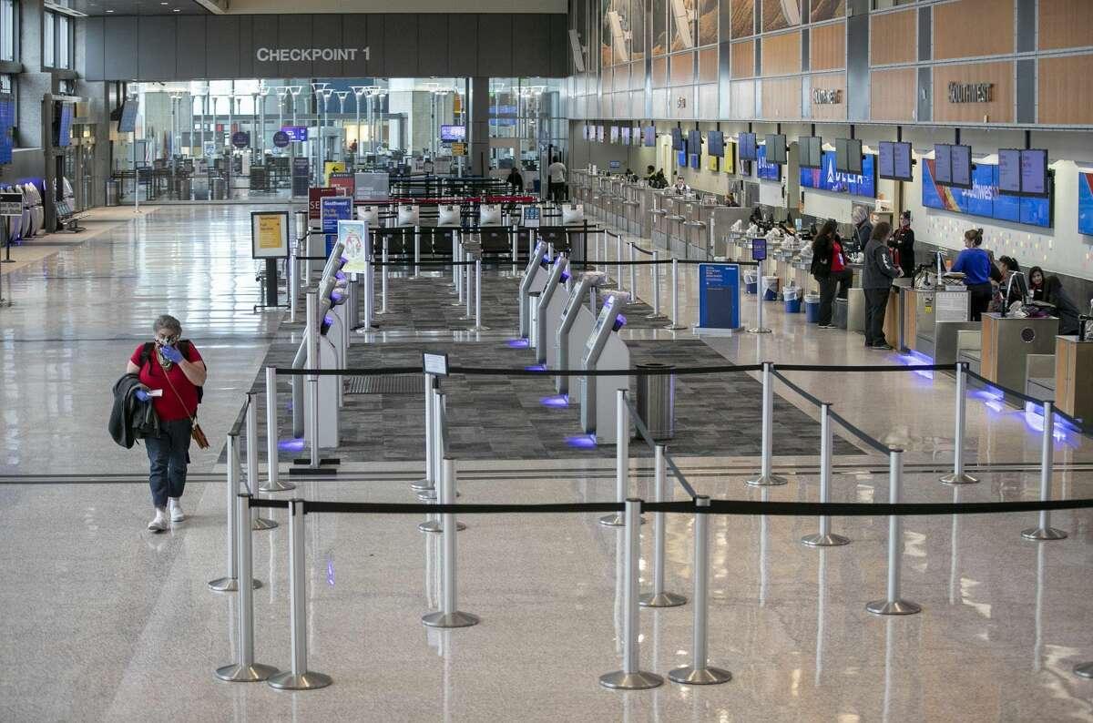 Austin-Bergstrom International Airport is nearly empty on Tuesday during the coronavirus pandemic. [JAY JANNER/AMERICAN-STATESMAN] >>>MORE PHOTOS: How Mexico is responding to coronavirus...