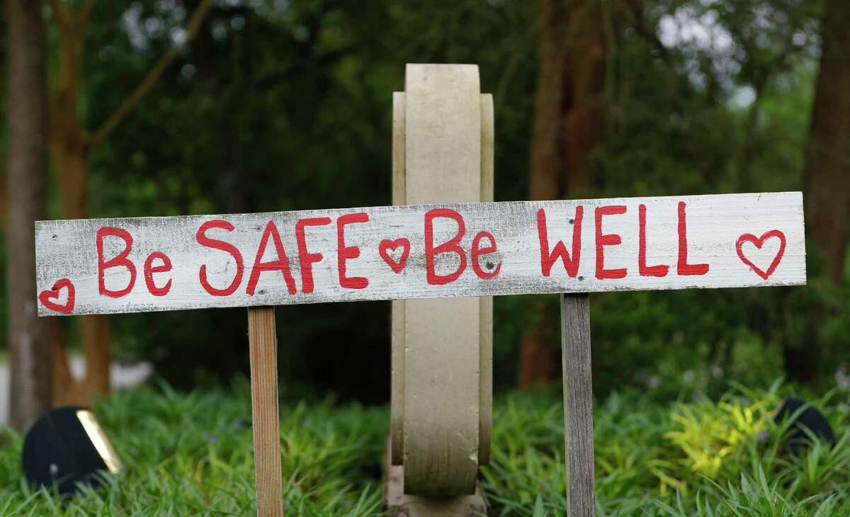 A sign of encouragement is seen along Research Forest Drive, Tuesday, March 31, 2020, in The Woodlands.