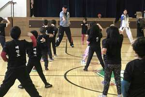 First-graders at Park Avenue Elementary School earned their white belts after completing a taekwondo program to combat bullying with Taekwondo instructor Master Kris Hyun from the Master Kris Foundation in Brookfield, CT.