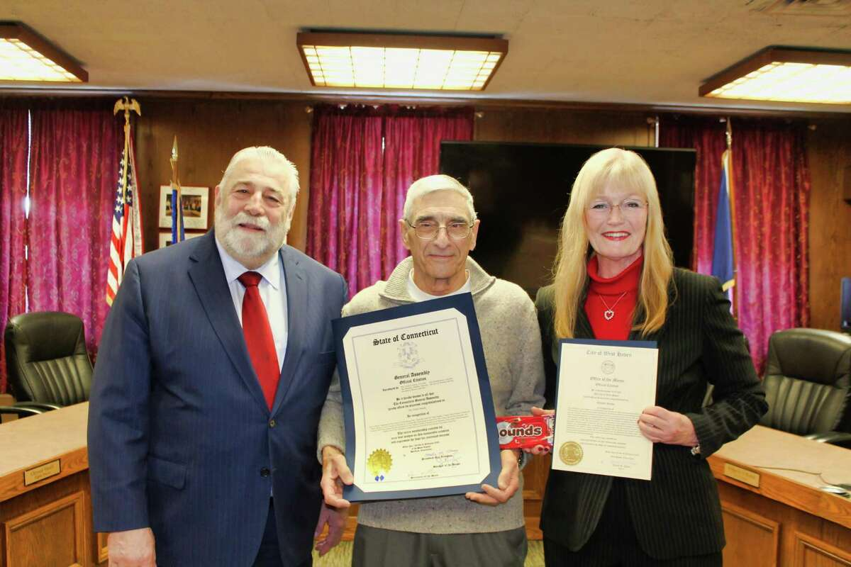 Vincent Nitido Jr., center, received citations Feb. 14 from state Rep. Charles J. Ferraro and Mayor Nancy R. Rossi honoring his father, the late Vincent Nitido Sr., as a brilliant mind in the industry of candy-making who created the famous Mounds bar 100 years ago.