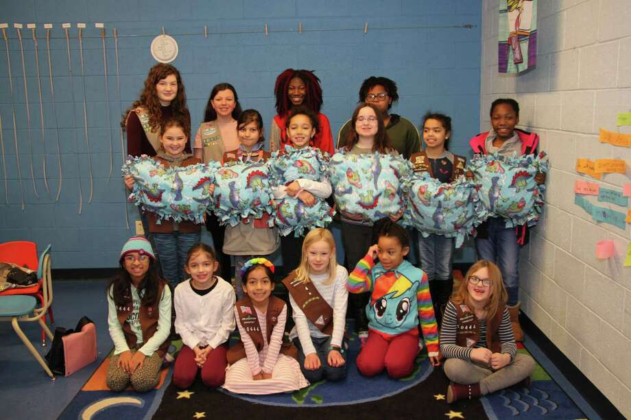 Brownie Troop 60444 and Cadette Troop 60110 came together to make no sew fleece blankets for cats. Photo: Contributed Photo