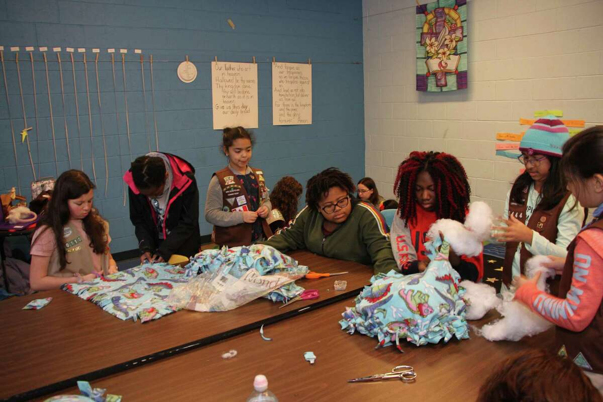 Brownie Troop 60444 and Cadette Troop 60110 came together to make no sew fleece blankets for cats.